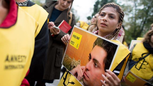 Saudi blogger who was flogged is awarded EU's top human rights prize