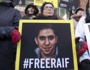 Badawi, takes part in a rally for his freedom, Tuesday, January 13, 2015 in Montreal. THE CANADIAN PRESS/Ryan Remiorz