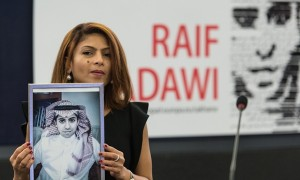 Badawi's wife, Ensaf Haidar, holds up a picture of her husband as he is awarded the EU's Sakharov prize. Photograph: Patrick Seeger/EPA