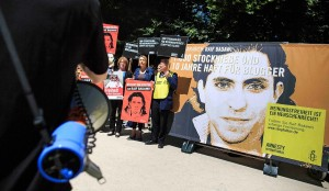 Protesters at the Saudi Arabian Embassy in Berlin on June 11, 2015. [Photo by Carsten Koall/Getty Images]